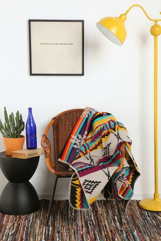 Inspiration for reading area near the window | Throw rag rug, wicker chair, southwest blanket throw, and pole lamp