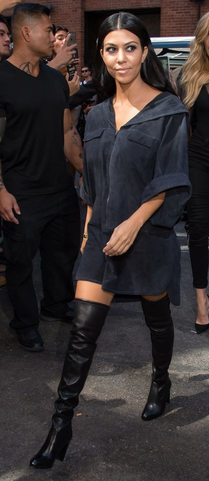 Taking a short shirt dress up a notch with a pair of over-the-knee boots, like Kourtney Kardashian.
