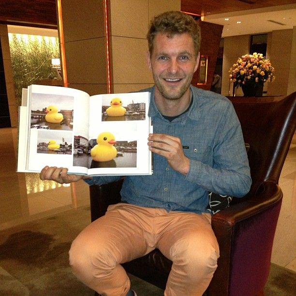 Florentijn Hofman with his acclaimed work the enormous Rubber Duck