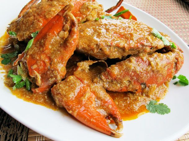 Singaporean Chili Crab 1 T cornstarch 7T oil 2 to 3 shallots,  (about 1/2 cup) 1 1/2- ginger, grated 6 medium garlic cloves, 4 Thai chiles, minced 2 whole Mud or Dungeness crabs  2 cups  chicken broth 1/4 cup tomato paste 1/2 cup hot-sweet chili sauce  1 large egg, beaten 1/2 cup thinly sliced green onions 1 cup chinese parsley leaves Rice or steamed chinese buns