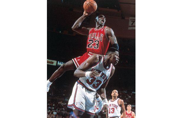 Michael Jordan dunking over Patrick Ewing in the Air Jordan VII Hare
