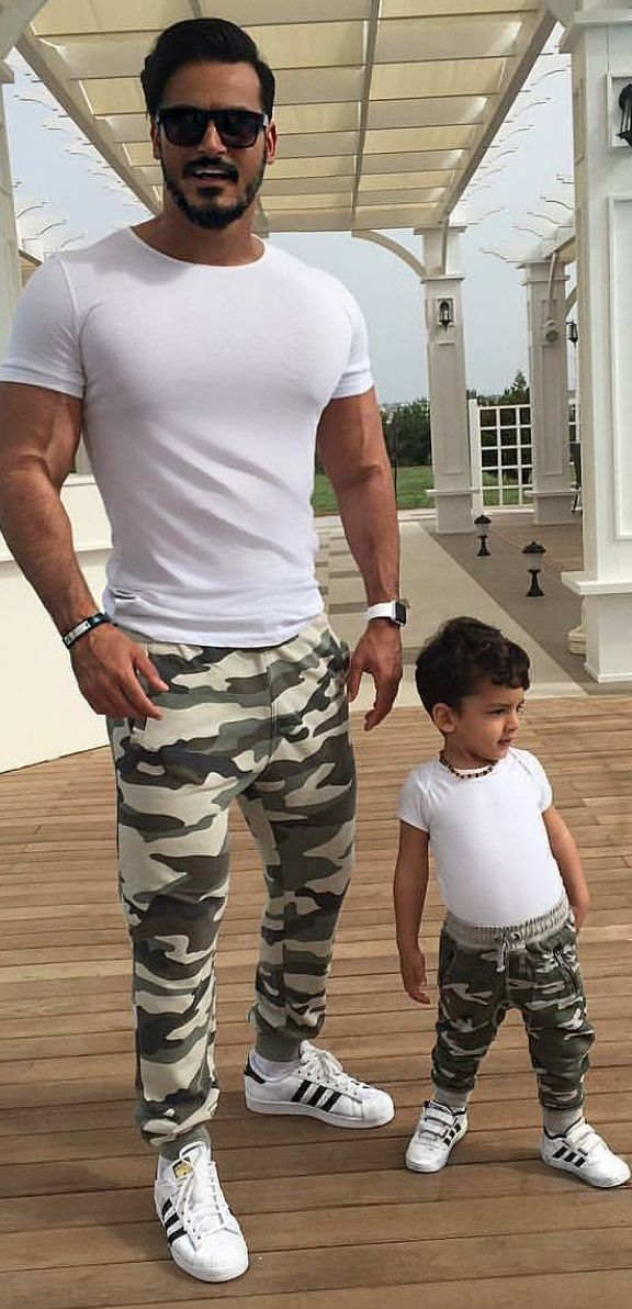 Hot on Instagram! 5,900 Likes so far. Who wore it better? Body-fitting White Tee, Adidas and Camo Joggers.
