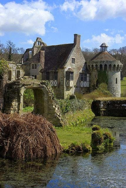 Scotney Castle is an English country house with formal gardens south-east of Lamberhurst in the valley of the River Bewl in Kent, England. It belongs to the National Trust. The central feature is the ruins of a medieval, moated manor house, Scotney Old Castle, which is on an island on a small lake.