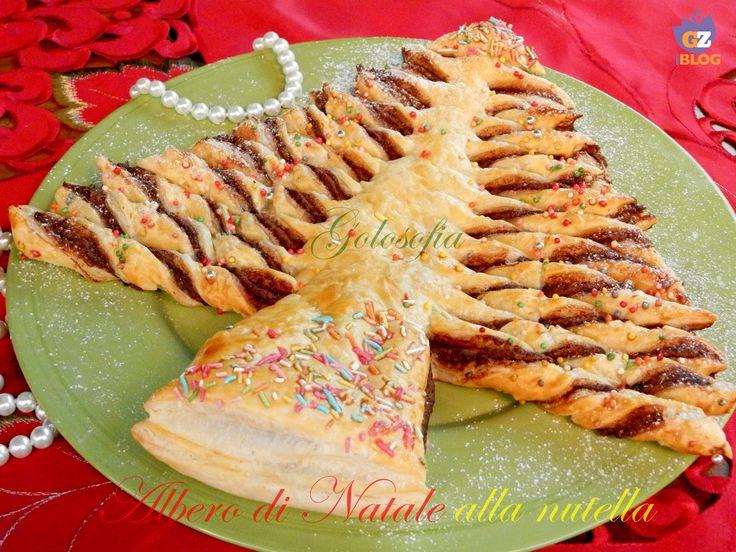 Albero di Natale alla nutella, un dolcissimo abete di pasta sfoglia, ripieno di nutella! semplicissimo da realizzare..;)