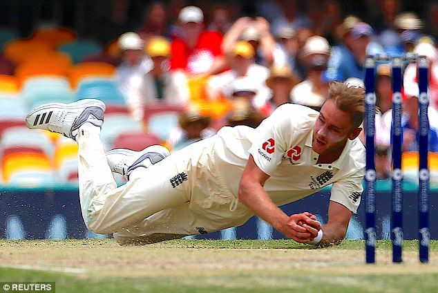 The England man dived low to take the catch to dismiss Mitchell Starc off his own bowling