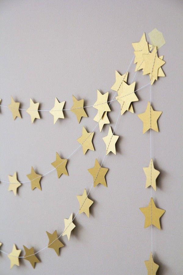 Guirlandes dorées motifs étoiles pour Noël