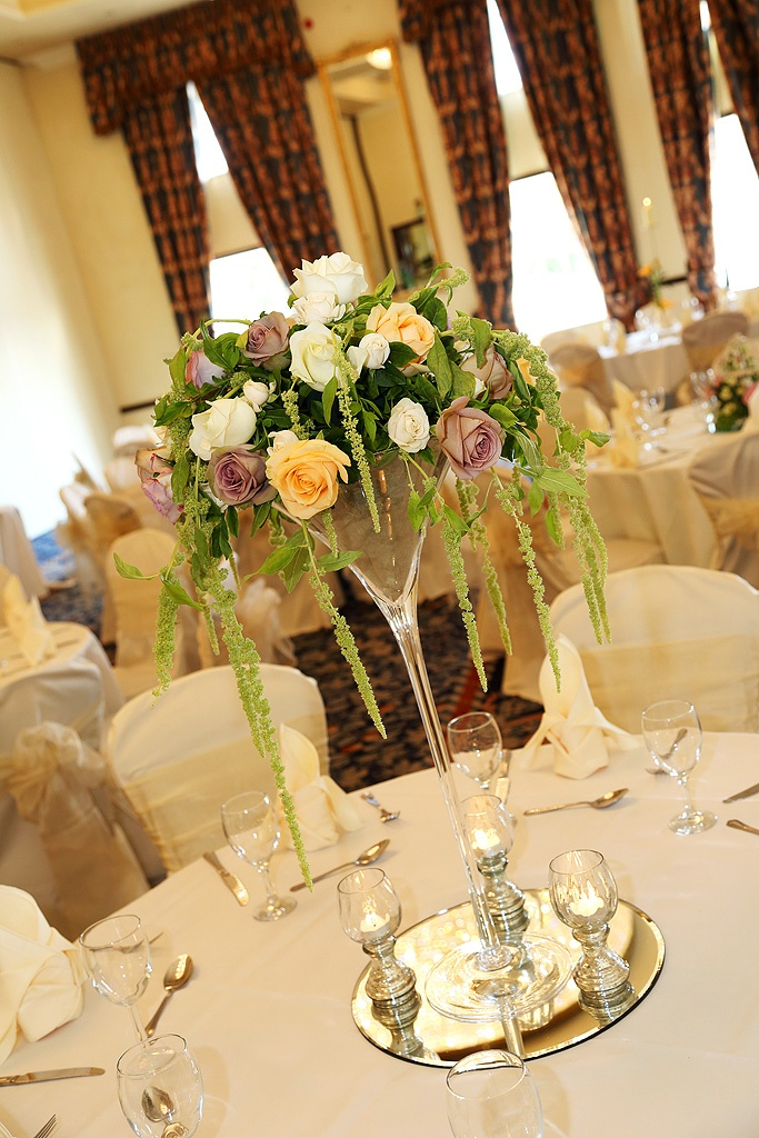 Stunning Glass Martini Vases Filled With Roses And Amaranthus Wedding Centrepieces