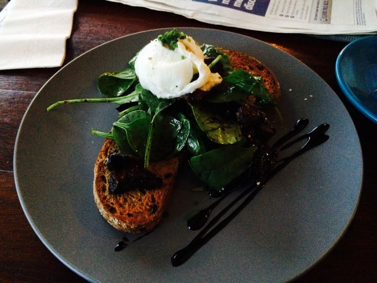 Balsamic mushrooms, goats cheese, spinach and a poached egg on rye with balsamic drizzle.