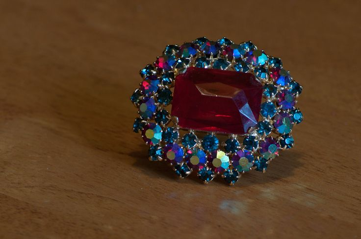Vintage Large Ruby Red  Stone with Blue and Red Rhinestone Gold Tone Brooch by…