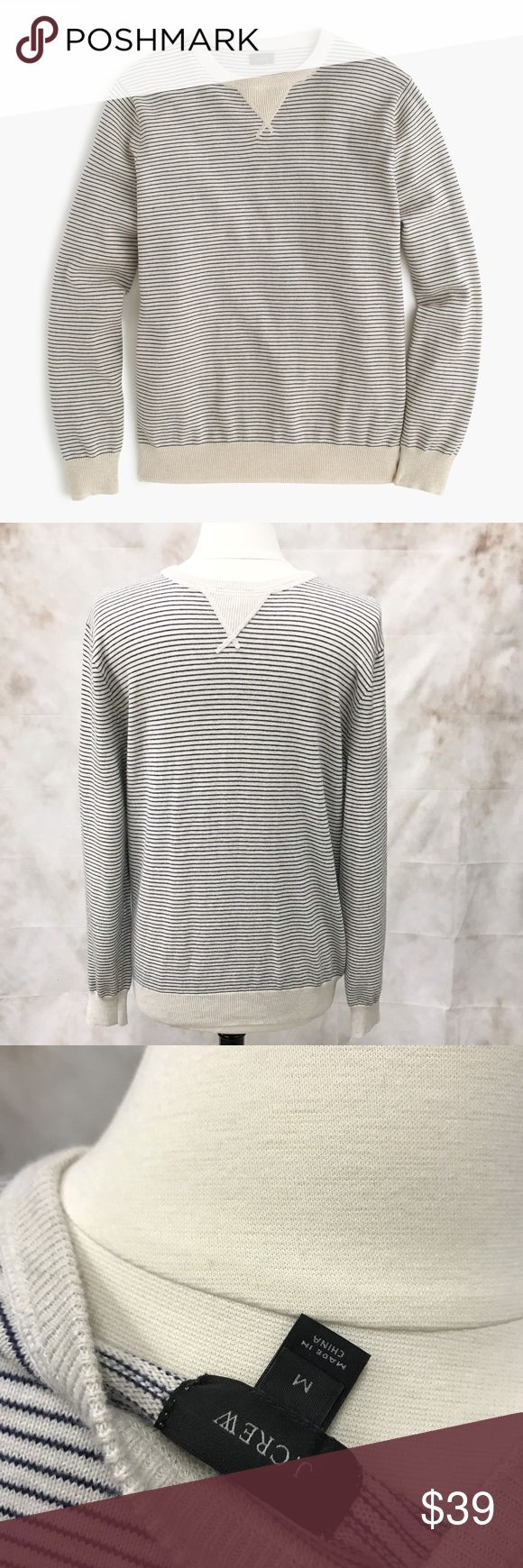 """J. CREW PINSTRIPE NAUTICAL SWEATER cotton B9177 J. CREW PINSTRIPED NAUTICAL SWEATER  color blue ivory gray size medium length 26"""" chest laying flat 19"""" sleeve 30"""" from neck seam Pre-owned condition  No stains or damage. Lightly worn a few times Please view all pictures All measurements are approximate  DETAILS The classic sweatshirt you know and love, now with nautical-inspired stripes (which means it can sneak under the dress-code radar—it has the polish of a favorite sweater with the…"""