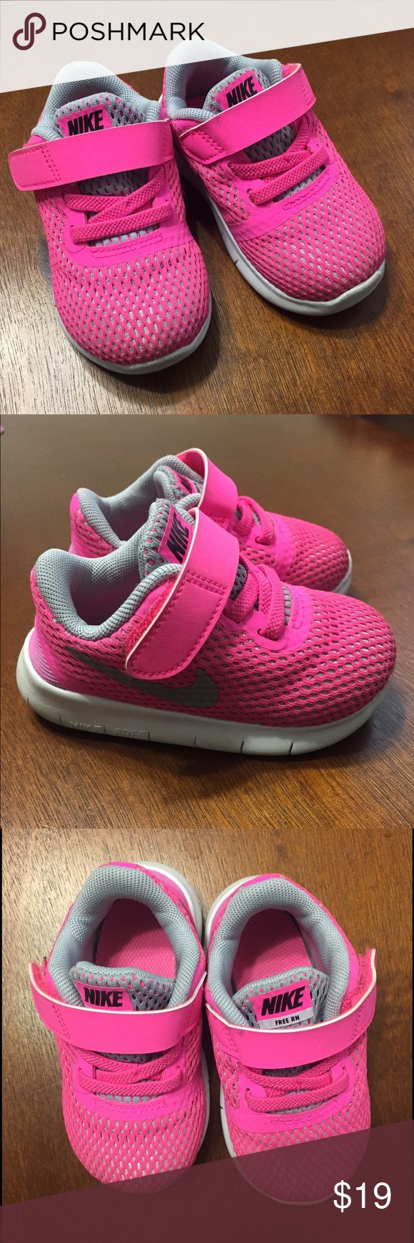 Excellent Condition Toddler Pink Nike Shoes Super cute, almost new toddler Nikes. Velcro closure. Size 4.5. Only signs of wear are a little bit of dirt on the bottoms of the shoes, otherwise immaculate. Nike Shoes