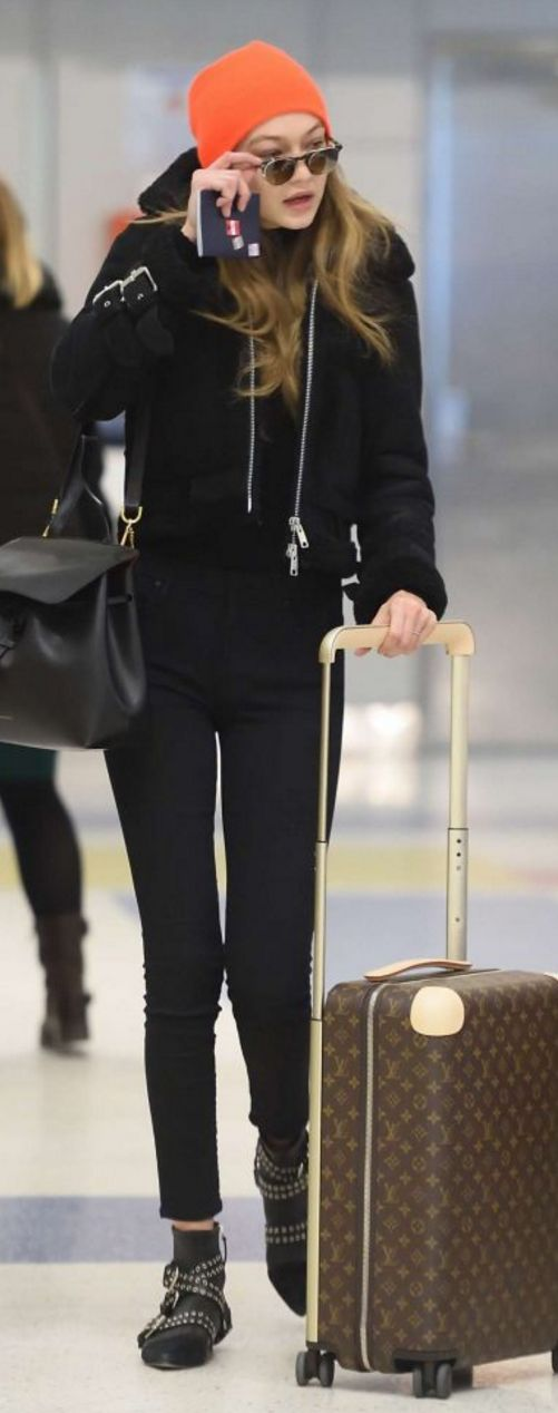 Gigi Hadid' in Luggage – Louis Vuitton  Jacket – AllSaints  Shoes – Isabel Marant