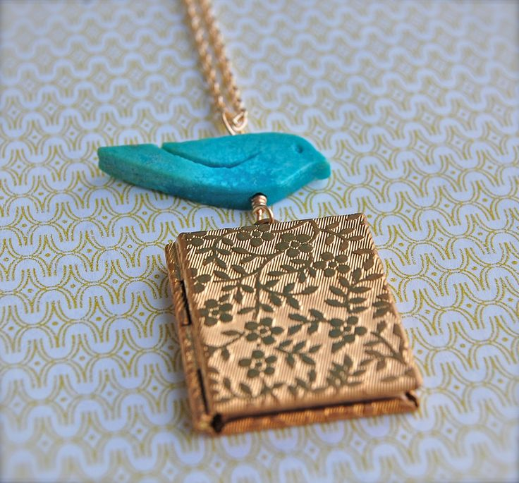 Turquoise Bird and Vintage Inspired Book Locket Necklace. $36.00, via Etsy.