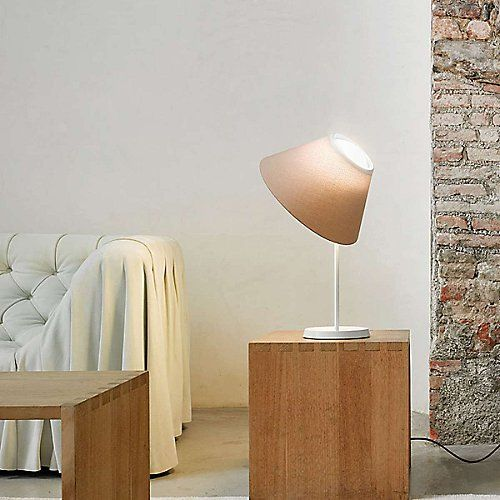 The Luceplan Cappuccina Table Lamp features a classic design with a modern twist. Designer Inga Sempé created a unique subtle ombré effect for the lamp's tapered shade that's inspired by the softness of the cappuccina flower. The shade balances on a round glass diffuser that houses an LED light, providing freedom of movement and flexibility of application.