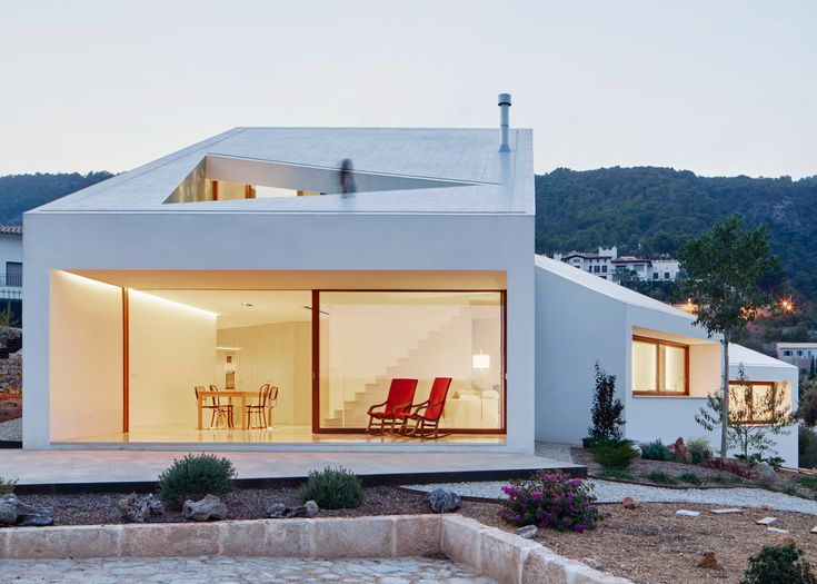 Oliver Hernaiz Architecture Lab has completed a house on the Spanish island of Mallorca, made up of white blocks that are all oriented towards different viewpoints