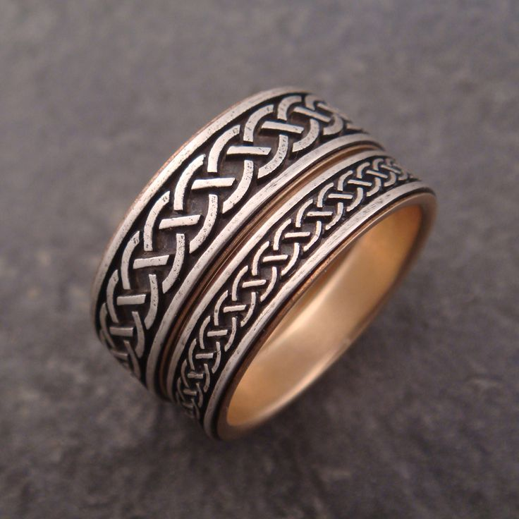 These were a custom order with a Celtic knot pattern provided by the customer. They are sterling silver with 14k gold linings.