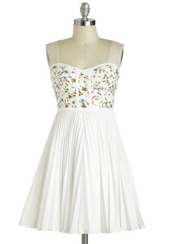 Simple white dress with a touch of floral print   why yes, i would love to join your tea party in my new dress.