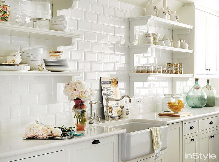 Lauren Conrad's newly revamped Beverly Hills penthouse captures the fashion designer's girlie vintage style. We can't stop fantasizing about baking in her all-white kitchen!   Source: Douglas Friedman for InStyle