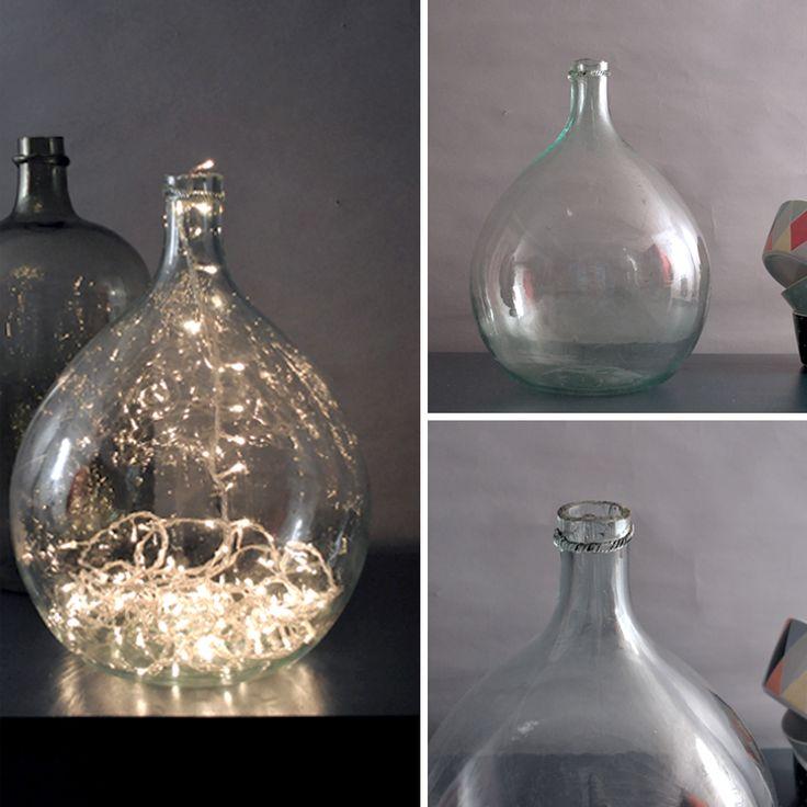 Dame Jeanne la bonbonne, qui se pavane ! Grande bonbonne en verre anciennement utilisée pour conserver l'eau de vie. Bel effet en élément de déco. En vente sur www.du-joli-dans-mon-logis.fr
