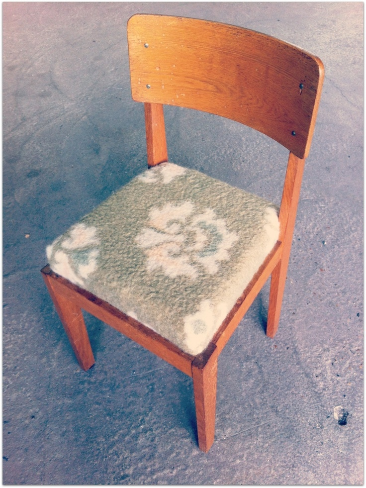 Restyled old chair with vintage blanket