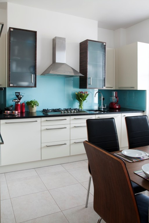 Kitchen White Cupboards And Light Blue Splashback Good