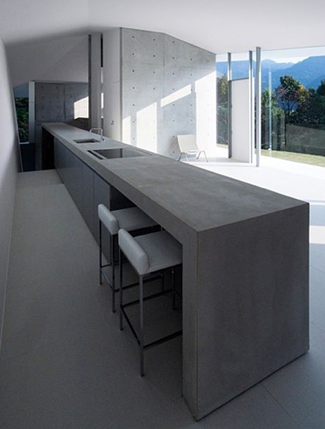 concrete kitchen also as corridor with stairs at the end. F House by Kubota Architect Atelier.