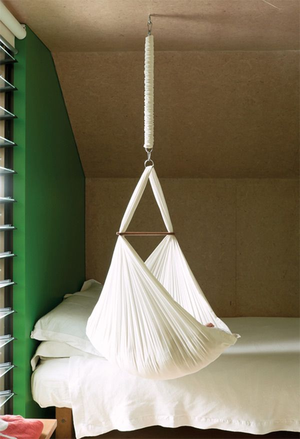 """According to some, a hanging crib makes the transition from womb to world a little easier for your baby. Suspended from the ceiling, the crib is gently sent into a rocking motion whenever the baby wiggles. This slight rocking movement calms baby and puts him back in dreamland."" Plus, this is just pretty."