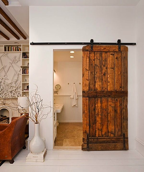 The door of this bathroom by the Brooklyn Home Company was sourced from a New Hampshire sheep barn.