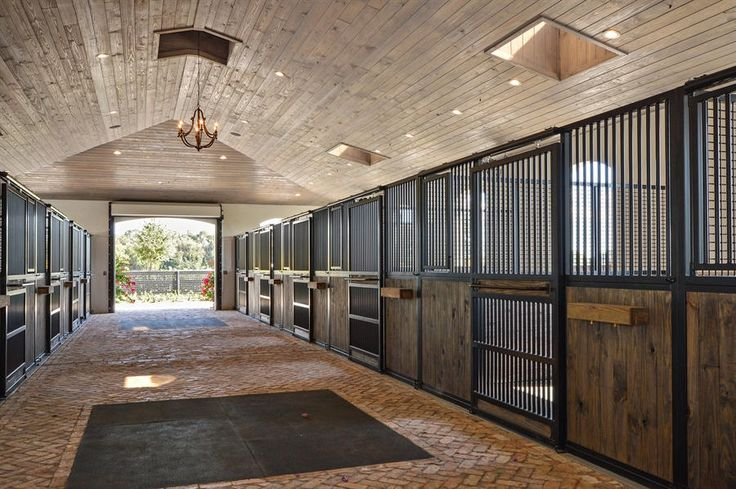 Ravello is an exquisite equestrian facility located in the prestigious community of Grand Prix Village South. This magnificent property features a twenty two stall stable, all weather ring, three paddocks, ring viewing area, and manager's apartment. Two gated driveway entries with Chicago brick welcome you with ample parking space.