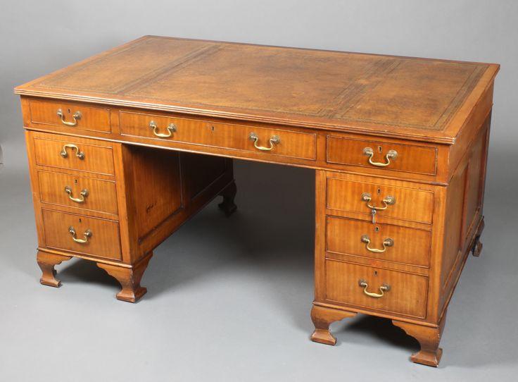 """Lot 815, An Edwardian mahogany partners desk with brown leather writing surface above 2 long and 16 short drawers with brass swan neck drop handles and escutcheons, raised on ogee bracket feet 30""""h x 69""""w x 36""""w, est  £650 - 750"""