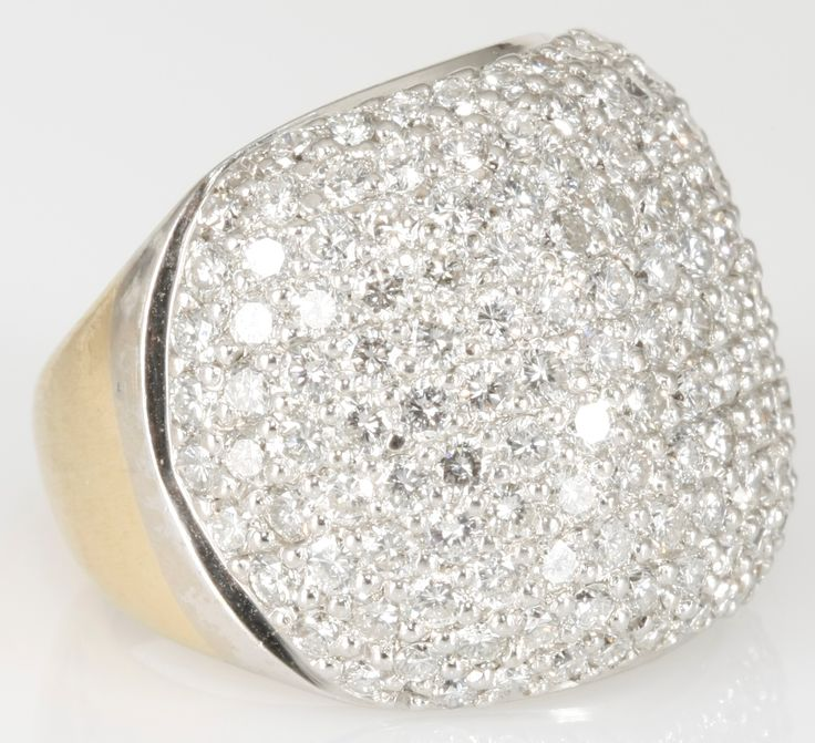 A DIAMOND CLUSTER RING, JENNA CLIFFORD   pavé-set with round brilliant-cut diamonds weighing approximately 3,20cts, in 18ct yellow and white gold, size K