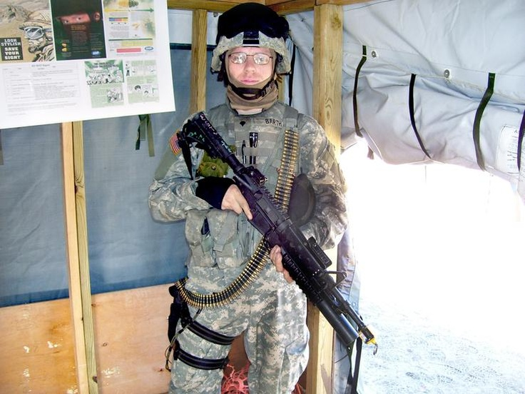 Sgt. Jesse Barth, a mechanic with the Illinois National Guard, pauses for this undated photo during a one-year tour in Iraq that stretched between 2006 and 2007. Barth, along with about 30 other veterans enrolled at Illinois Central College, have not received various education benefits from the U.S. Veterans Administration. Barth has been unable to get the VA to answer his calls to explain the delay, and ICC hasn't had much better luck with the agency.: App, Undat Photo