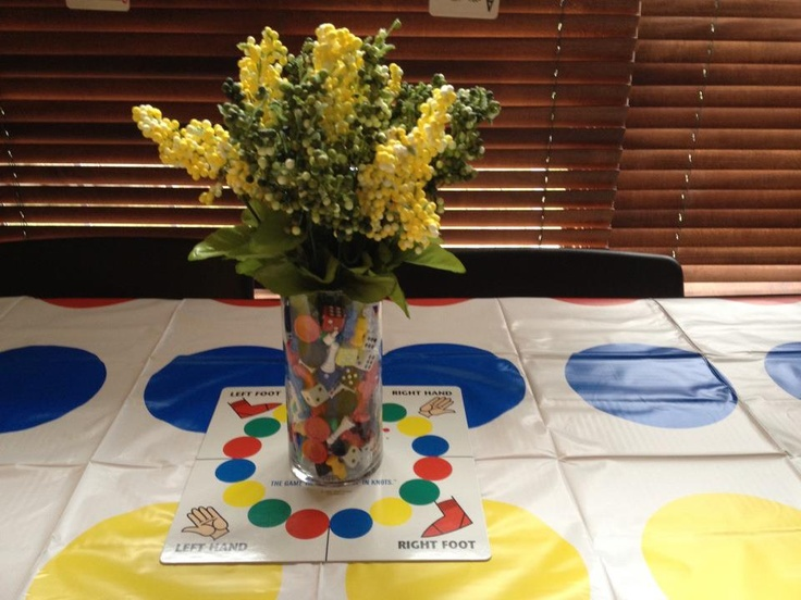 """""""Game Night"""" party - I used a twister mat for the tablecloth. I took pieces from dif games and put in vase then stuck flowers (artificial) in vase. Sat that on top of the twister spinner board (without the plastic spinner) and used this as my centerpiece."""