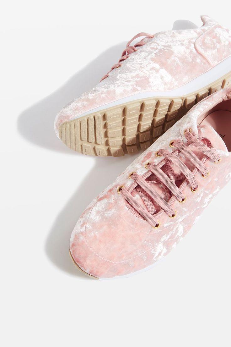 Pink velvet runner trainers.