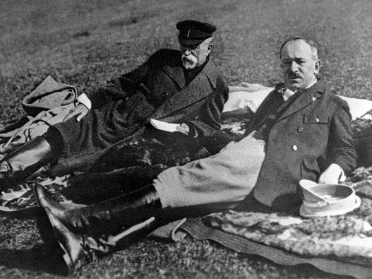 President of Czechoslovakia Tomáš Garrigue Masaryk (left) and Minister Edvard Beneš lying in the grass in Topolčianky.