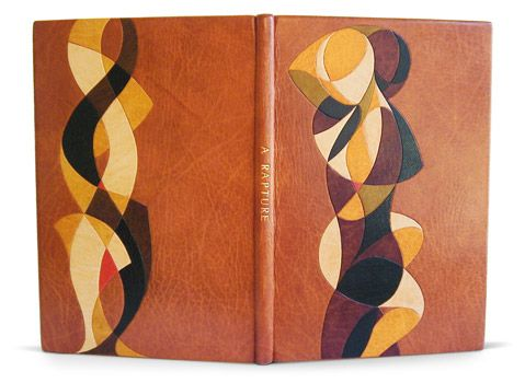 A Rapture A poem by Thomas Carew. Illustrated by J.E. Laboreur The Golden Cockerel Press, 1927. Limited edition: 144 of 375 Bound 2009. 183 x 126 x 10mm A full leather goatskin binding. The cover design (from an original drawing by the binder) in multiple cushion pared onlays and hand- lettered on the spine. Paper doublures. Housed in a dark and golden brown cloth covered box lined in dark brown suede. Bound by Simeon Jones.