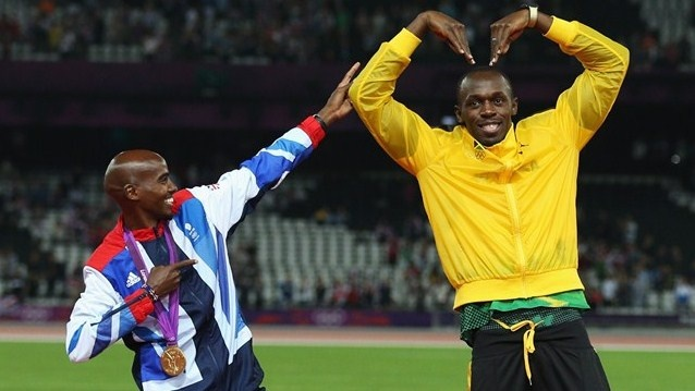 Gold medallists Mo Farah and Usain Bolt of Jamaica pose on the podium