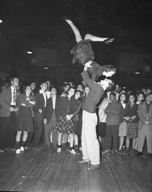 "Jitterbug dance contest, San Francisco, c. 1940s ""The term jitterbug comes from an early 20th-century slang term used to describe alcoholics who suffered from the ""jitters"" (i.e., delirium tremens).The term became associated with swing dancers who danced without any control or knowledge of the dance. In popular culture, it became generalized to mean swing dancers themselves (jitter bugs), or a type of swing dance –  ""they danced the jitterbug"""