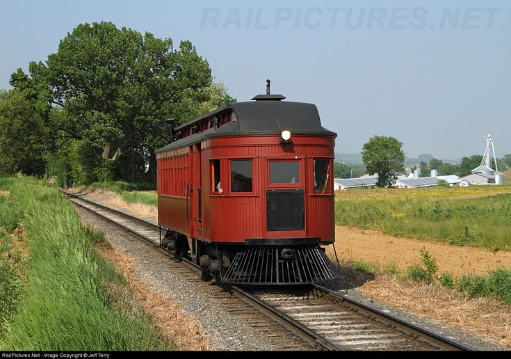 Strasburg's motor car No. 10 scampers along at Esbenshade Road, heading back to Strasburg with a late afternoon run. Assembled from a wooden passenger coach in 1915, it operated for two years as a narrow gauge motor car before being converted to standard gauge in 1918.