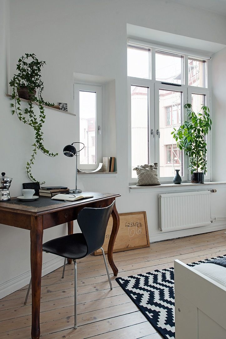perfect little workspace in the bedroom vintage desk and fresh green plants