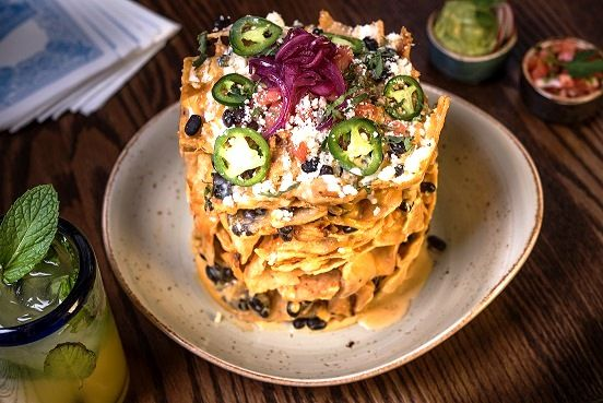 Guy Fieri serves up the Trash Can Nachos at El Burro Borracho--one of his restaurants in Las Vegas.