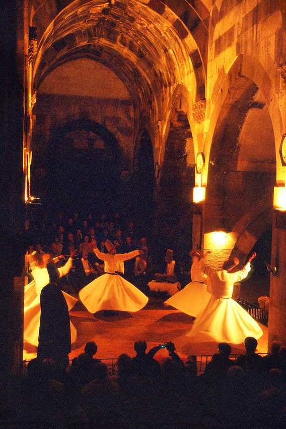 Whirling dervishes perform the Sena at the Caravanserai, Sarihan, Cappadocia, Turkey.