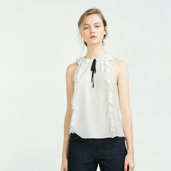 ($25 thru offer button tonight)Zara ruffle blouse Super cute. Tie in front and back. Great alone or with a blazer Zara Tops Blouses