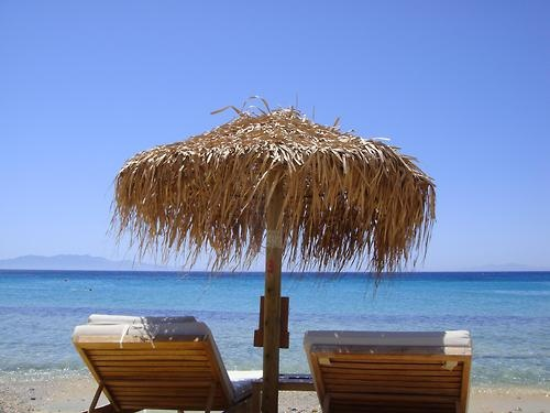 Mykonos sunbathing on the beach with friends