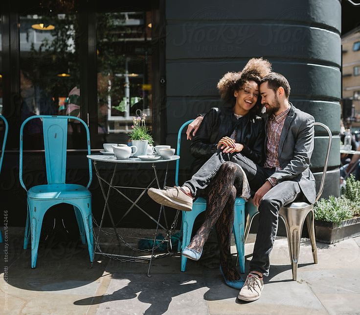 Young couple relaxing sitting at cafe.