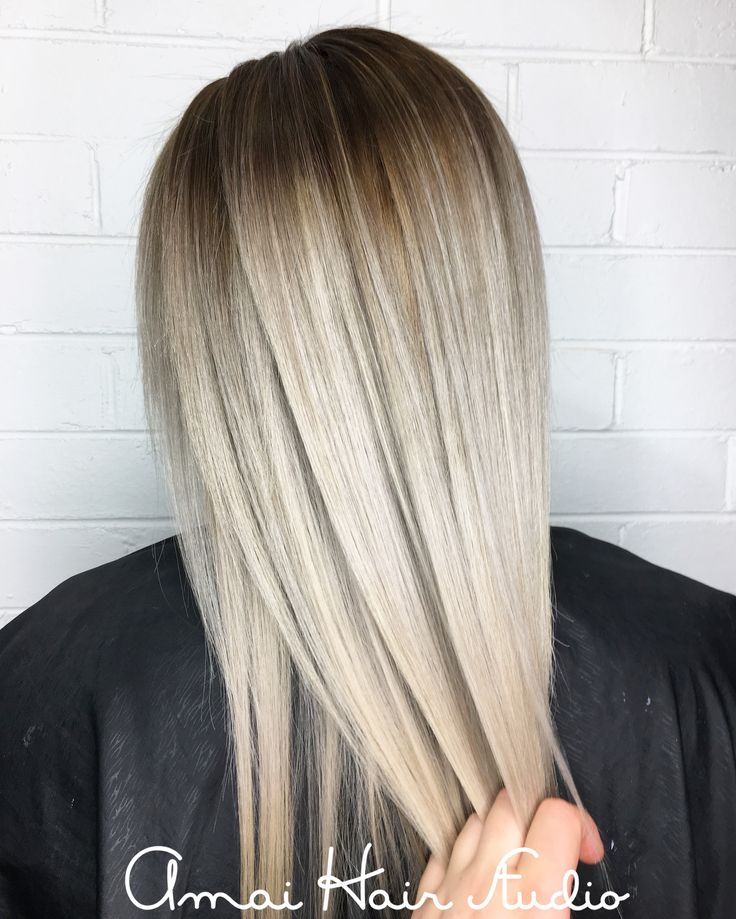 White blonde hair. Platinum blonde with shadow root. Amai Hair Studio