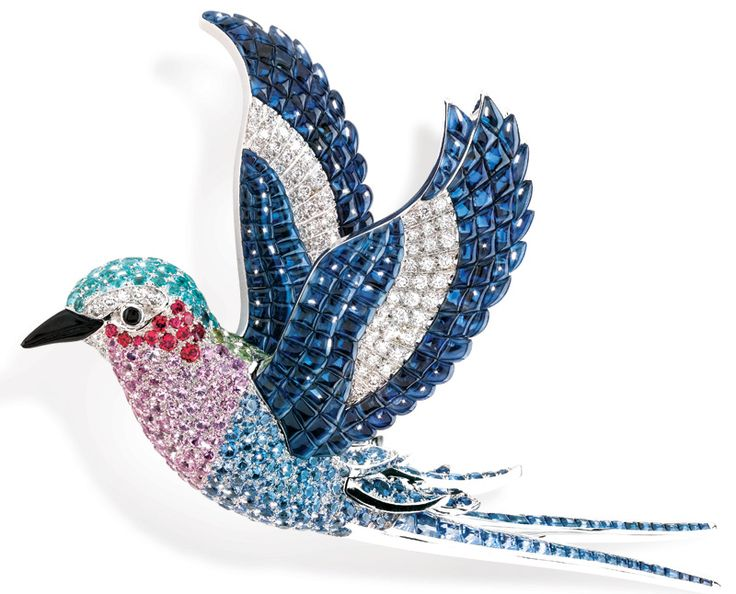 """FLY AWAY The Lilac Breasted Roller clip from Van Cleef & Arpels' """"Les Voyages Extraordinaires"""" collection features diamonds, spinels, tourmalines, garnets, onyx, and blue and pink sapphires set in 18-karat white gold."""