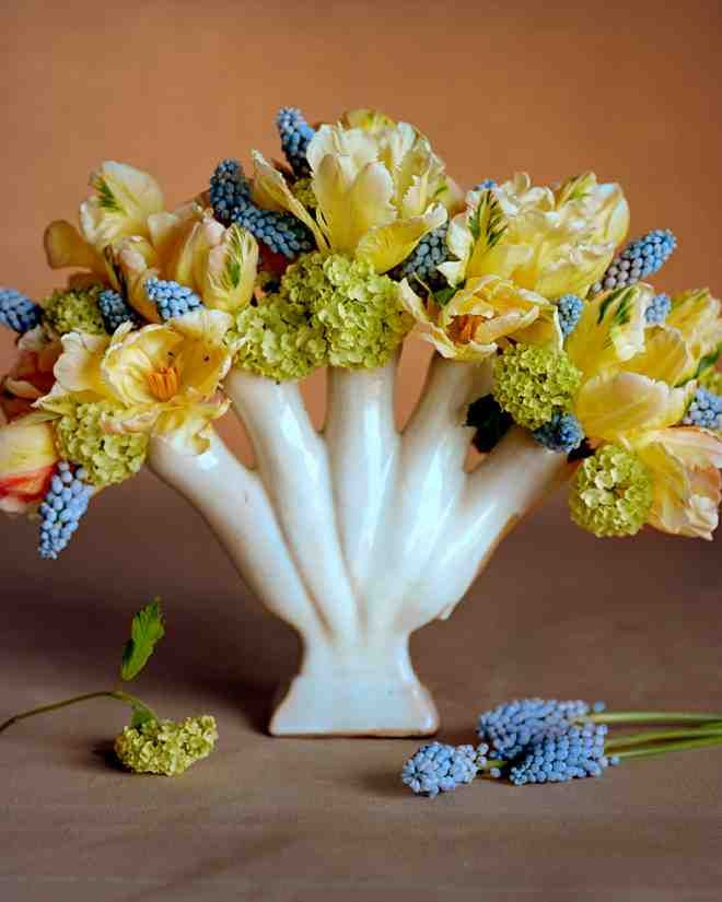 """Bright and Early Arrangement  A European tulipiere was designed to display one tulip in each """"finger."""" """"I love to mix small fringed tulips with early viburnum and muscari in this vessel,"""" says Martha."""