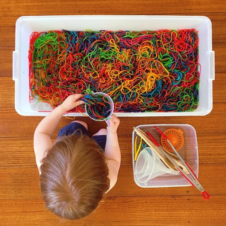 Rainbow spaghetti sensory tub. Cook 2 packets of cheap spaghetti, divide it into six bowls, add a different food colouring to each, then stir until the spaghetti is well covered.