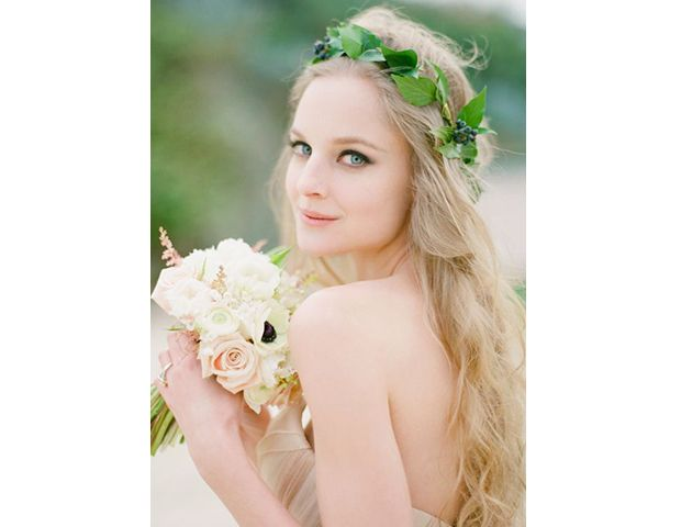 @Byrdie Beauty - It's hard to rival the organic simplicity of an ivy-leaf wreath on half-up half-down hair. Part woodland fairy, part Roman laurel, equal parts elegant.
